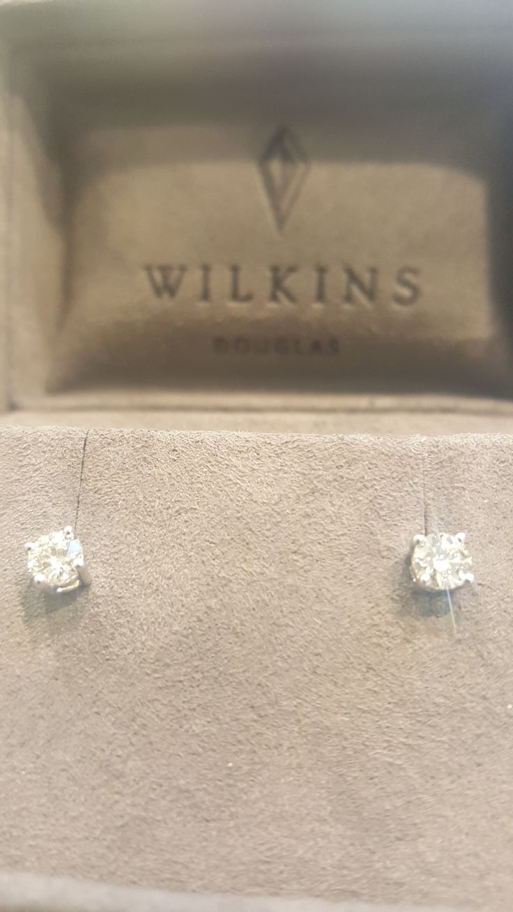 .40 solitaire earrings in white gold