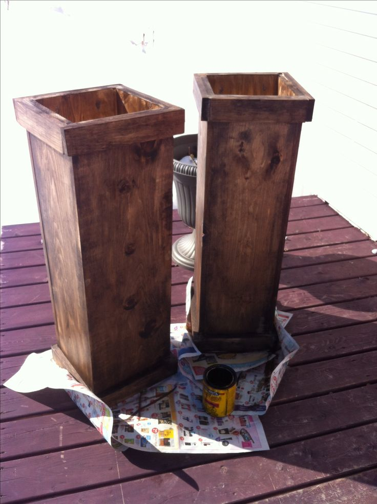 Tall wooden planters.. So simple and very inexpensive considering how much ones at the store cost!! This cost me under $50 for both not including glue, screws and stain.