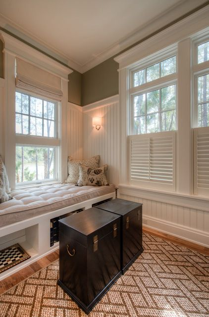 Traditional Family Room by Solaris Inc.  Half shuttered windows.