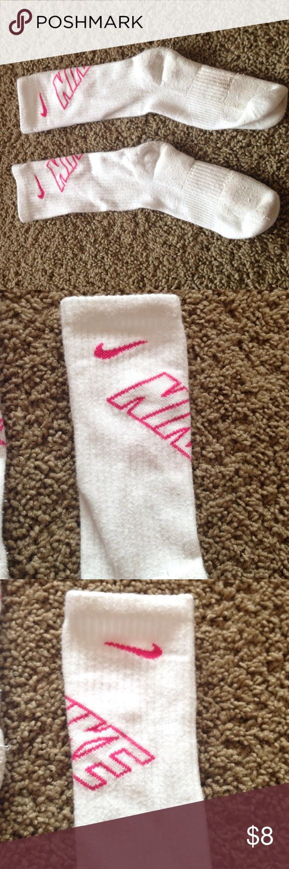 Nike socks White nike women's medium socks with a pink NIKE sign. Used with No holes. Dirt stains on bottom. Taking offers. Nike Other