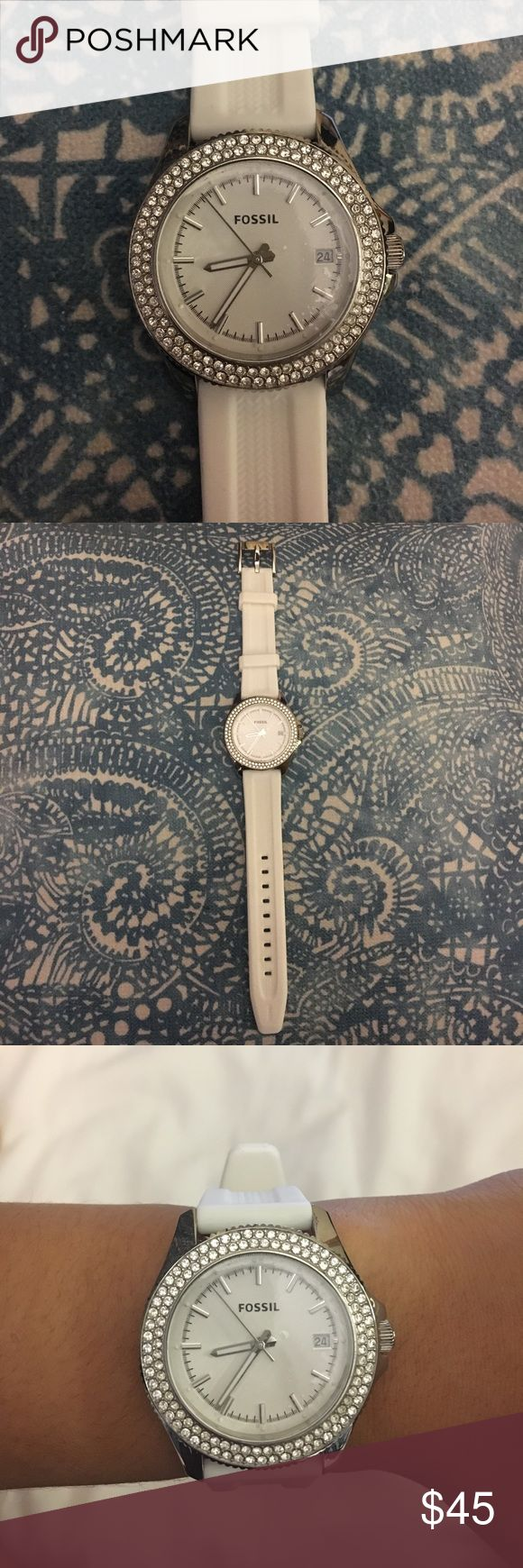 Fossil watch White fossil watch with silicone watch strap. In great shape, the white strap is very clean. Still has the clear film covering the face of the watch. Can include a fossil box. Needs a new battery. Fossil Accessories Watches