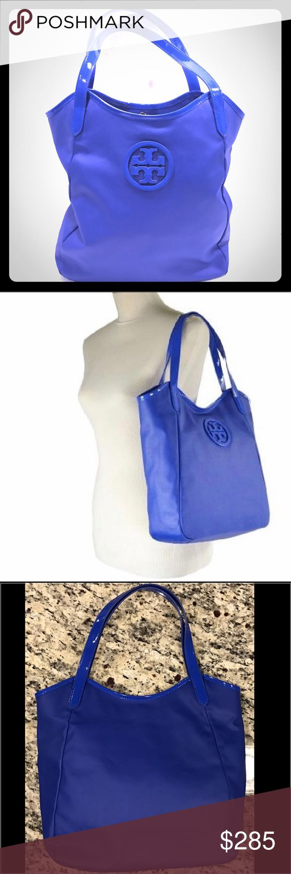 "Tory Burch Tote Tory Burch Dipped Canvas Stacked Logo Tote in blue.  Coated canvas with patent leather trim.  Approx 12"" x 13"" x 5"". Double straps with 7.5"" strap drop.  Magnetic snap closure.  Interior zip pocket and 2 slip pockets.  Fabric lining, gold tone hardware. Large TB logo on front, gold TB logo inside. Emblem inside still has protective film over it.  Perfect condition.   Absolutely no signs of wear. Tory Burch Bags Totes"