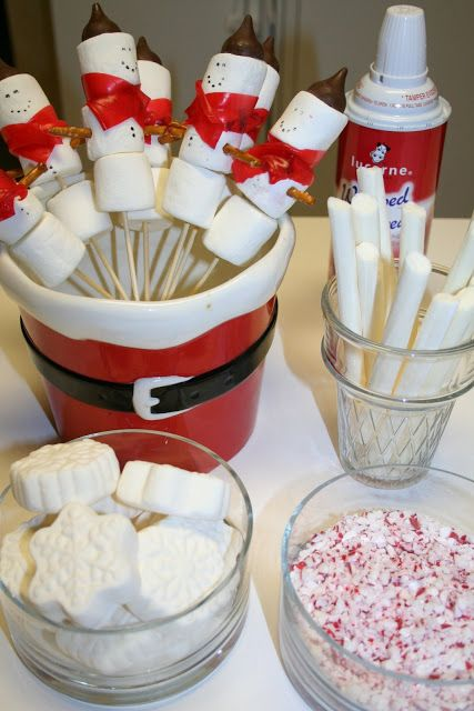 Hot Cocoa Party with marshmallow snowmen (scarves are fruit roll ups, hats are Hershey kisses), vanilla sipping straws (Harry & David), crushed peppermint candies, snowflake shaped marshmallows (Target), and whip cream