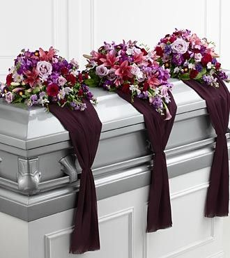The FTD® Refreshing Mix™ Casket Spray is a set of three arrangements that flank the top of the casket for an exquisite and sophisticated look, ideal for a closed casket service. The center arrangement