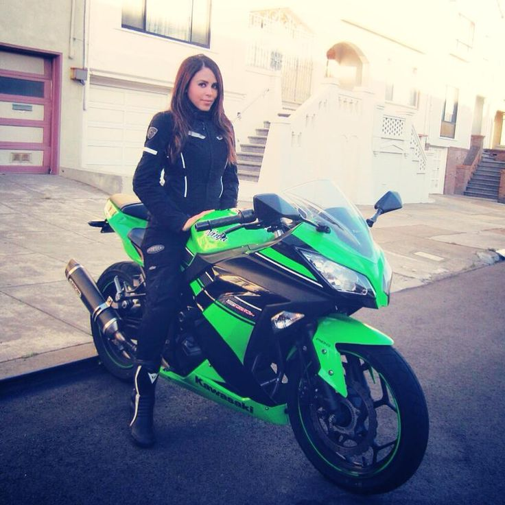 """Miss Annette Carrion with her Kawasaki Ninja and new jacket, """"My new Rev'It! Sand jacket is keeping me nice and warm in the cool..."""