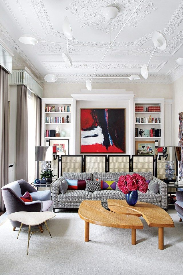 A larger seating area, with a Sixties Pierre Chapo 'L'Oeil' coffee table and a sofa covered in Brentano's 'Boxed In'; and behind it a desk area concealed with panels by the artist Margie Britz