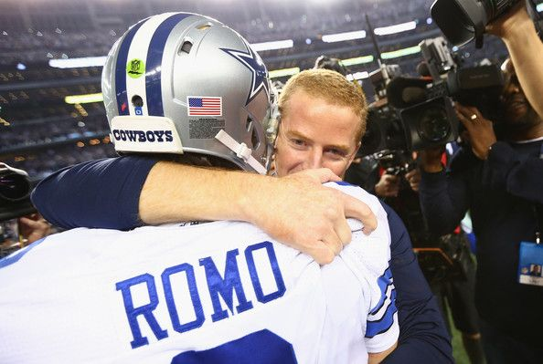 Tony Romo Photos Photos - Tony Romo #9 of the Dallas Cowboys hugs coach Jason Garrett after their 24-20 win against the Detroit Lions in their NFC Wild Card Playoff game at AT&T Stadium on January 4, 2015 in Arlington, Texas. - Wild Card Playoffs - Detroit Lions v Dallas Cowboys