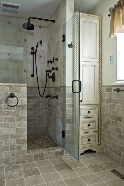 Using every inch of space by putting a tall utility cabinet in the bathroom for linens & such...