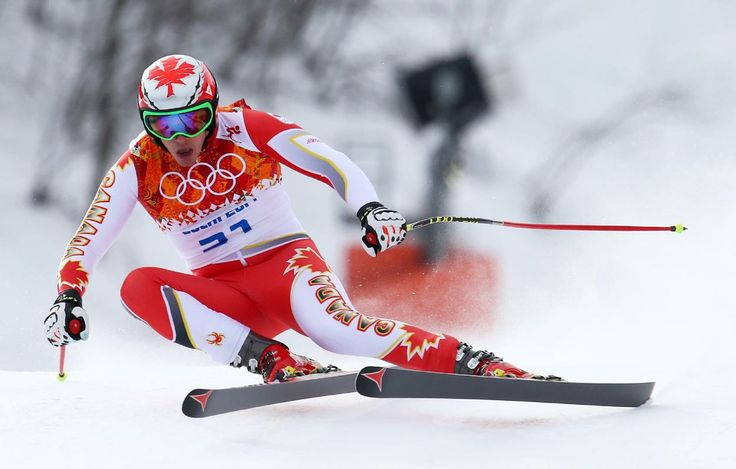 Canada's Erik Guay (Mont Tremblant, Quebec) makes a turn during the men's downhill at the Sochi 2014 Winter Olympics, Sunday, Feb. 9, 2014, in Krasnaya Polyana, Russia. (AP Photo/Alessandro Trovati)