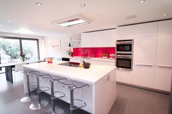 White, open plan kitchen with large windows