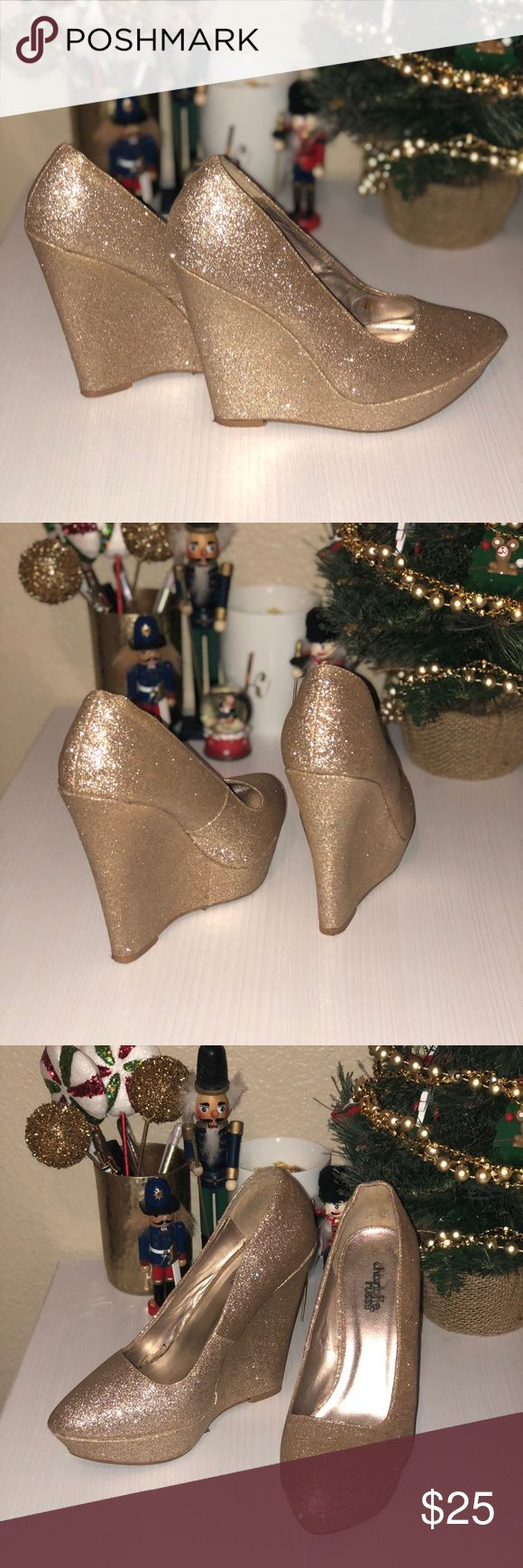"""Gold Wedge Heels Gold sparkle wedges. Perfect for holiday parties and everyday glam! I love these so much but never get to wear them.  Heel is 5"""" high, and has gold glitter all over. Charlotte Russe Shoes Heels"""