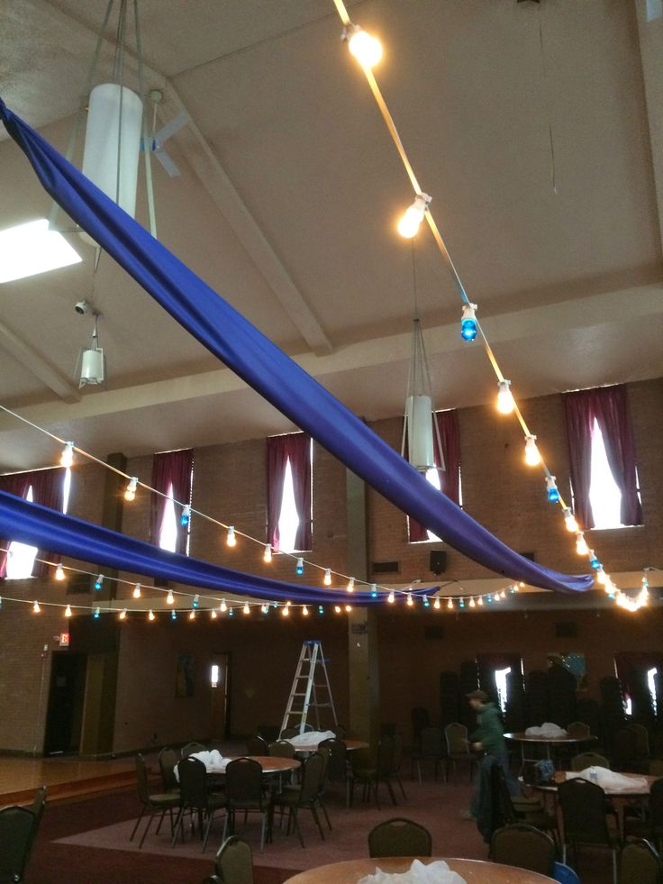 Fabric swags and bistro lighting