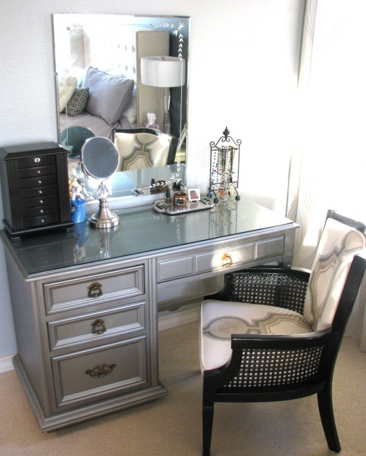 this is the exact desk i just bought for a vanity. Except it is still wood colored. Deciding what color to paint. Thinking this color or emerald for my peacock theme??