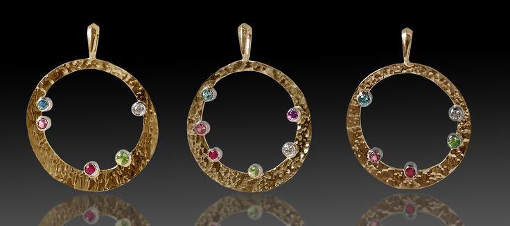 14 karat yellow and white gold family stone pendants