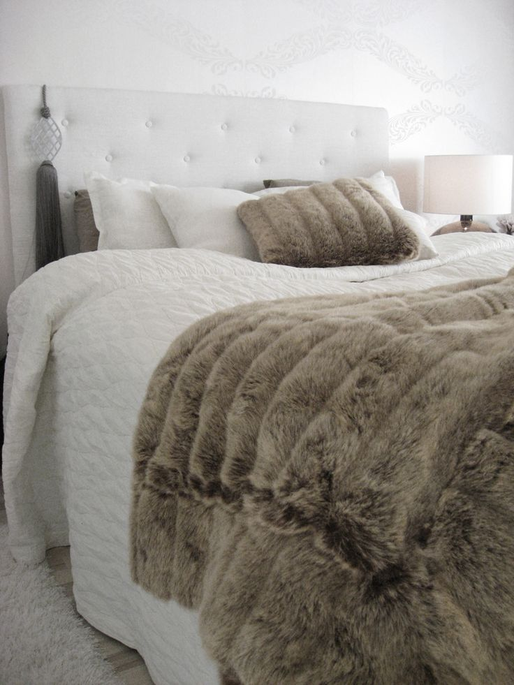 White and brown bedroom, white bedspread, white button headboard