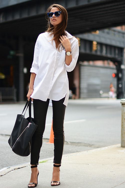 Consider teaming a white oxford shirt with black slim trousers for a sleek elegant look. For the maximum chicness opt for a pair of black leather heeled sandals.   Shop this look on Lookastic: https://lookastic.com/women/looks/dress-shirt-skinny-pants-heeled-sandals-tote-bag-sunglasses/8564   — Navy Sunglasses  — White Dress Shirt  — Black Skinny Pants  — Black Leather Tote Bag  — Black Leather Heeled Sandals