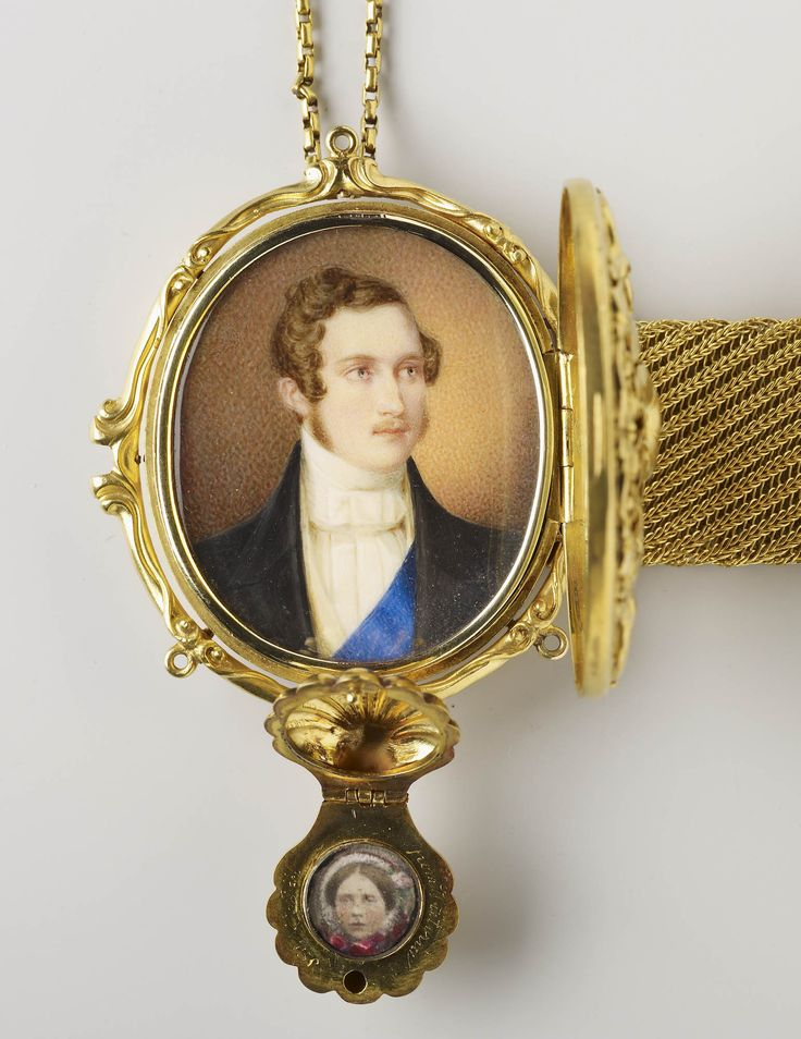 Minitaure of Prince Albert; bust-length, in evening dress with the ribbon of the Order of the Garter. Set in a flexible gold bracelet clasp supplied in 1860 by Garrards (RA GL, 29 November 1860), the lid with engraved inscription ALBERT / 1840 and applied floral decoration; the reverse with four-leaf clover and engraved inscription Coburg 1st October 1860 and pendant shell, engraved from Victoria / 1st Feb 1858, containing photograph of Victoria, Princess Royal; the gold bracelet wi...