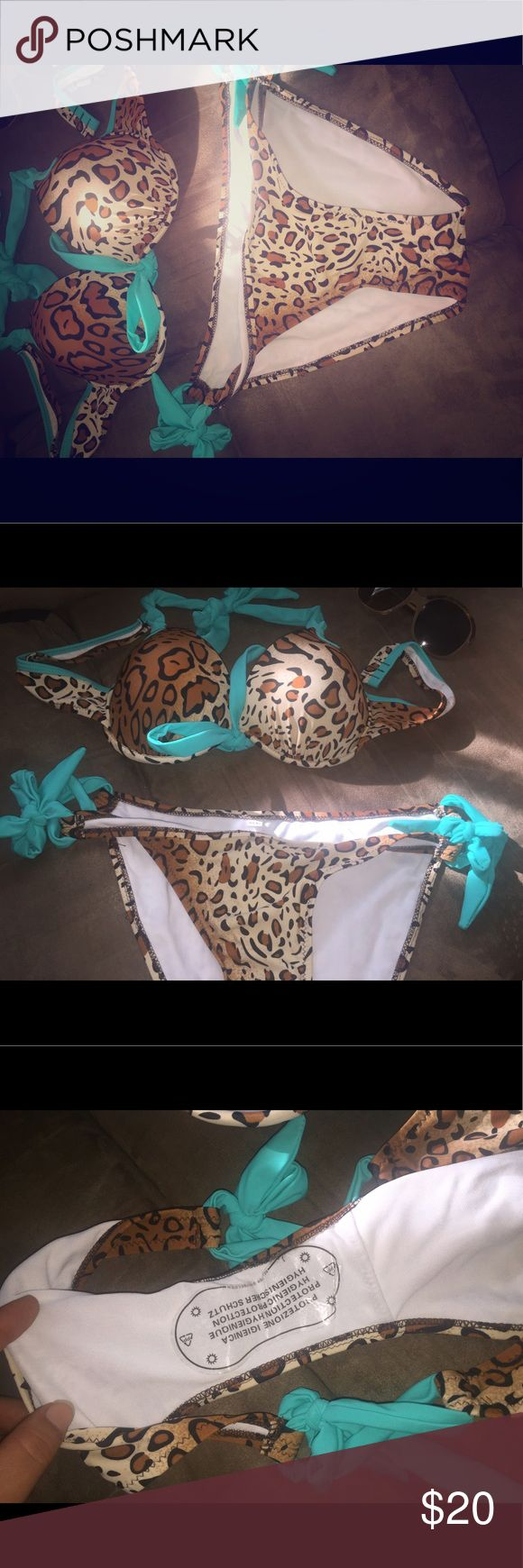Leopard bikini with turquoise accents size L Never worn bikini leopard size L Swim Bikinis