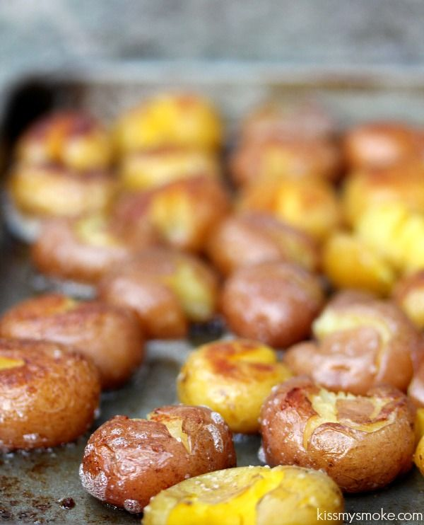 Grilled Smashed Potatoes   kissmysmoke.com   Ruby and Golden Mini Potatoes cooked in chicken broth, then smashed and cooked on the grill with butter, and coarse salt. Absolutely delicious!