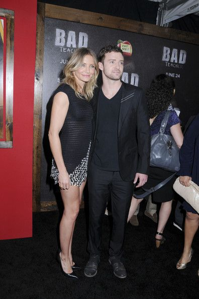 "Cameron Diaz Photos Photos - Old flames Cameron Diaz and Justin Timberlake get close as they pose for photographers at the ""Bad Teacher"" premiere at  the Ziegfeld Theatre in New York. - 'Bad Teacher' Premiere in New York"