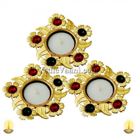 Vedicvaani.com| Designer Diyas| Online Store for Designer Diyas, Designer diya in the shape of Sudarshan chakra studded with bright white and red gems. All auspicious functions and moments like daily worship, rituals, and festivals and even social occasions like inaugurations commence with lighting of lamp, which is often maintained right through the occasion.