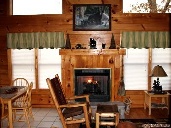 Twilight Ridge is a Luxury Log Cabin with a spectacular view of Mt. LeConte. Sit in the hot tub and look over one of the highest peaks in the Smoky Mountains. This one bedroom cabin is filled with relaxing and enjoying amenities such as a jacuzzi tub, Harvard Double Shoot Basketball Game, Pool table and mountain views galore. When you stay at Twilight Ridge you will enjoy being in the heart of the mountains but so close to everything. #fun #cabin #view #mountain