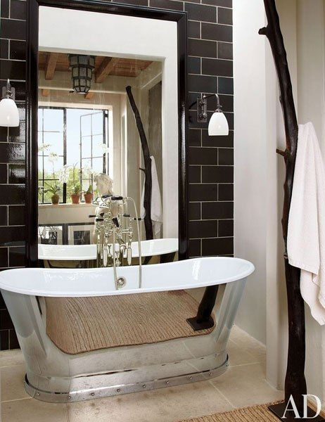 manhattan bath features sconces and a tub by urban archaeology and a - New York Bathroom Design