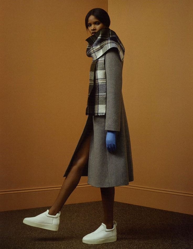 IO DONNA Italy fashion editorial featuring Fay coat and scarf.