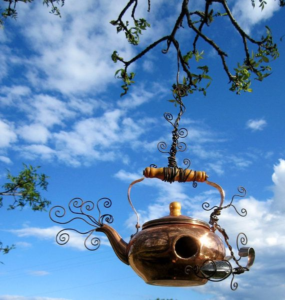 tea kettle and wire birdhouse