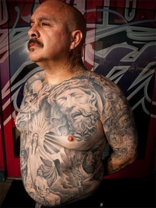 """Colloquially deemed """"Lowrider tattoos"""" because of the titular car that shows up in much of this artwork, Chicano ink has a strong past and a promising future in the world of tattoos."""
