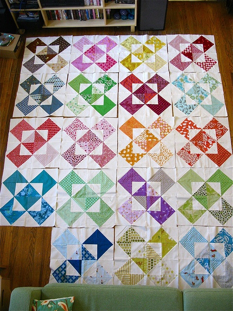 Just a picture but way cute! 1/2 square triangles. It's all in the layout.