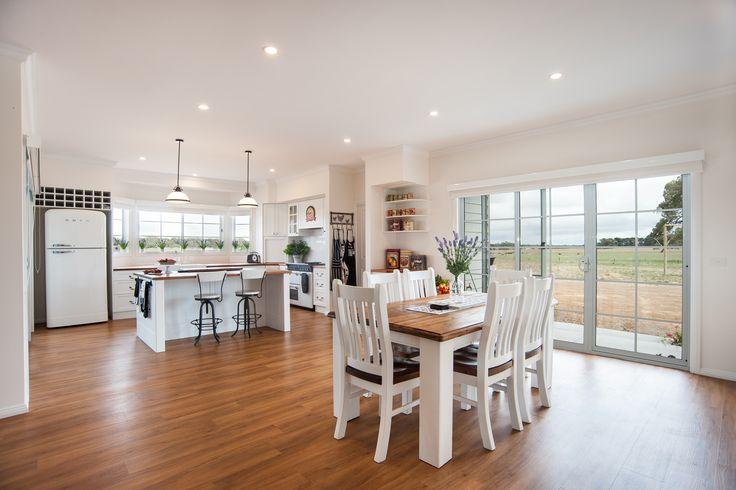 Elegant country kitchen. White cabinet doors, Blackwood benchtops, Smeg retro fridge.