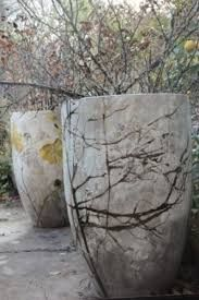 Hypertufa/concrete planter idea: give your pots a branched tree effect by adhering branches to the edge of a mold with some hot glue.