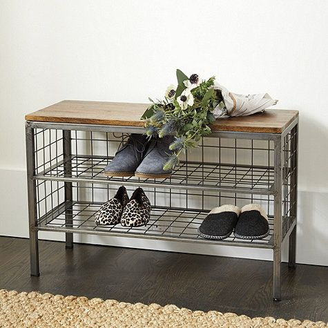 LOVE - the industrial/rustic contrast, the functionality (bench + storage), also that it is raised on legs off the floor - feels less heavy that way
