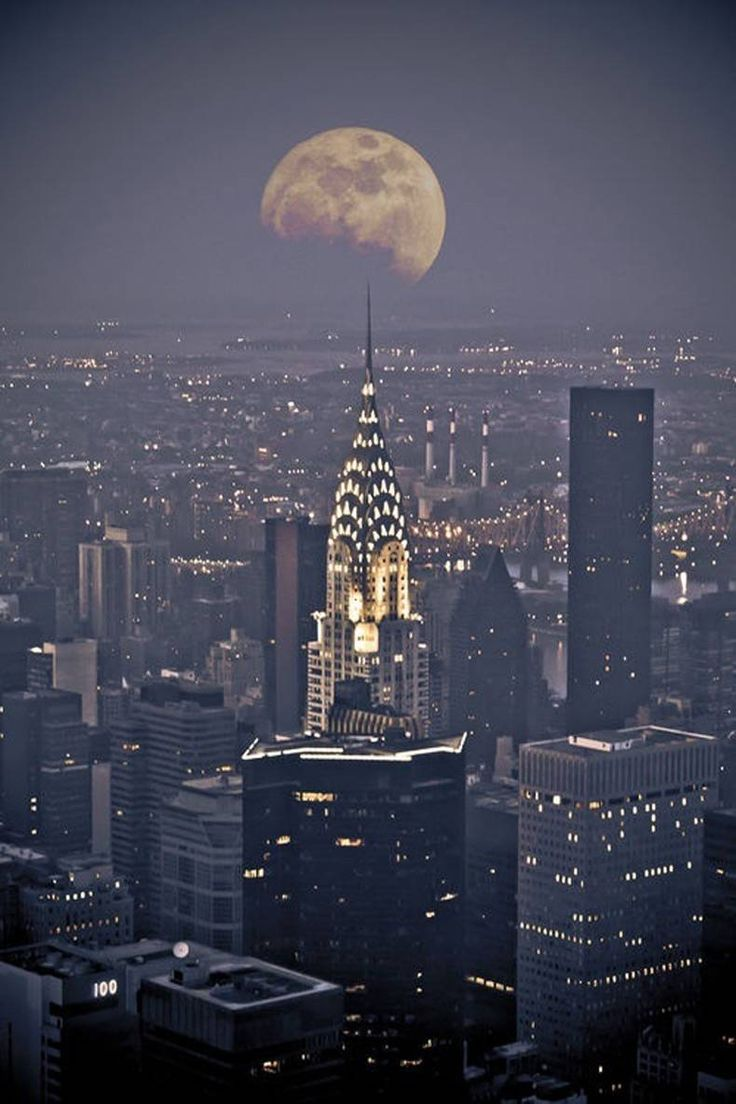 The Chrysler Building facing the moon.