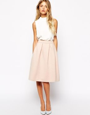 be on trend in this vila quilted a line midi skirt from asos a steal at $40  Love the skirt shape