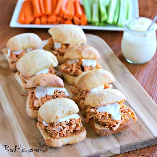 Slow Cooker Buffalo Chicken Sliders are an awesome way to feed a hungry crowd on game day! So easy to make and packed with chicken wing flavor everyone loves!