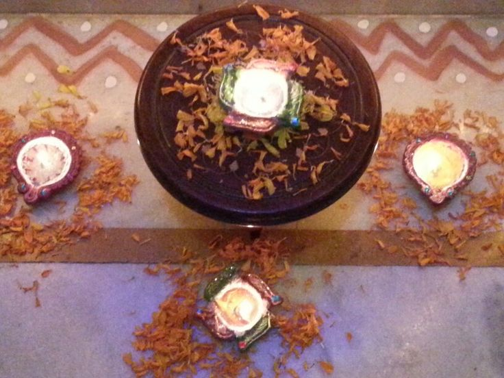 Lighted Diya(s).... tiny mud pots filled with mustard oil...