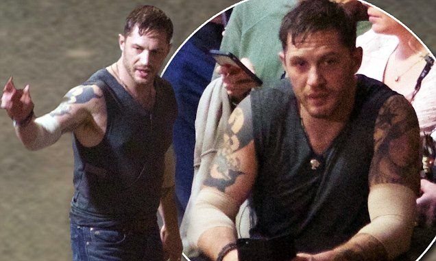 Tom Hardy looked to be taking a time out on Friday as he reclined on a garbage dumpster on set, in between takes.