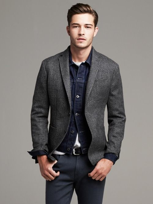 Go for a dark blue denim jacket and dark grey chinos for a casual level of dress.  Shop this look for $234:  http://lookastic.com/men/looks/denim-jacket-crew-neck-t-shirt-belt-chinos-blazer/6493  — Navy Denim Jacket  — White Crew-neck T-shirt  — Black Leather Belt  — Charcoal Chinos  — Charcoal Wool Blazer