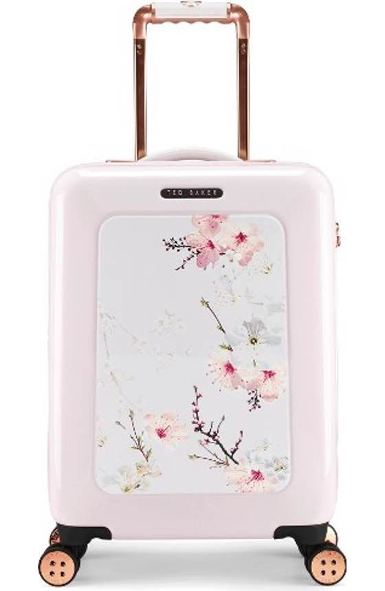 Free shipping and returns on Ted Baker London Large Four-Wheel Suitcase (31 Inches) at Nordstrom.com. A lightweight suitcase designed with four smooth-rolling 360-degree wheels for easy concourse navigation is made from aircraft-grade aluminum and tough-as-nails polycarbonate to help it withstand the rigors of travel. A lush floral print ensures it stands out from the crowd at baggage claim.