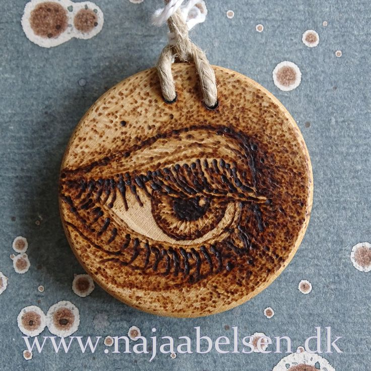 Necklace of wood, eye made with pyrography. 4,8 cm. String of hemp. Made by www.najaabelsen.dk
