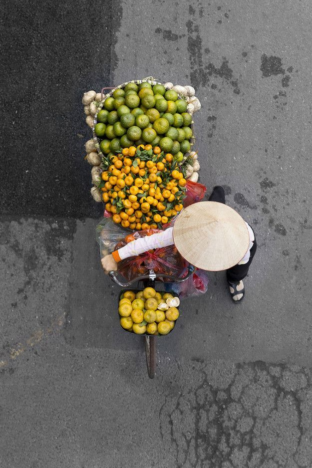 Dutch photographer Loes Heerink highlights the colorful diversity of Vietnam's bicycle-riding fruit sellers.