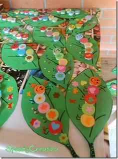 ruspjes van dopjes collage paper craft caterpillars -kids could make any creature / insect on a leaf and display together