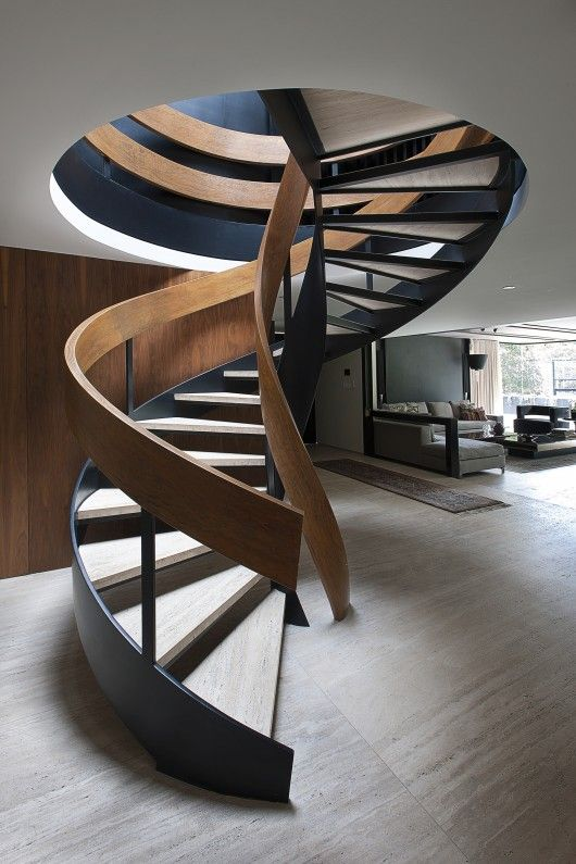 Modern Stairs // sculptural wood spiral stairs make a statement at the Casa Lomas II by Paola Calzada Arquitectos
