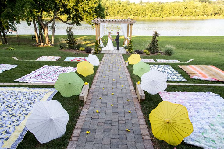 Picnic blanket ceremony lined with paper umbrellas | Citrus Infused Lakeside Country Wedding With Laid Back Whimsy | Photograph by Complete MVP  http://www.storyboardwedding.com/citrus-lakeside-country-wedding-laid-back-whimsy/