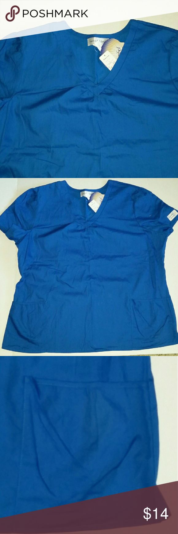 XL NWT SANIBEL SCRUBS Scrub top royal blue *CUTE* Sanibel scrubs cute royal blue scrub top Cute gathered detail around the neck and pockets. Size XLarge 55% cotton, 45% polyester  Style# SA636 New with tags  *If interested I do have the matching pants Size large & lab coat Size Large also listed.* sanibel scrubs  Tops