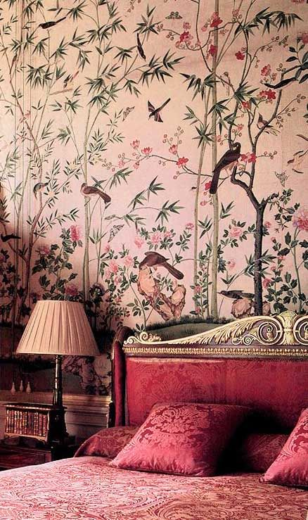 This image defines a Chinoiserie (18th-19th century) bedroom. A strong design element used is the asian designed wallpaper, use of gold details and pink silk.    .
