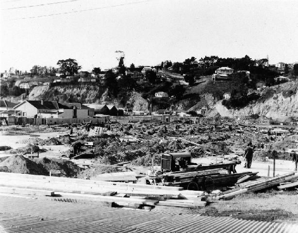 The photograph shows Ahuriri after the devastating 3 February 1931 earthquake. The image has been taken looking towards Napier Hill. Photographer, Dave Williams. Date, post 3 February 1931