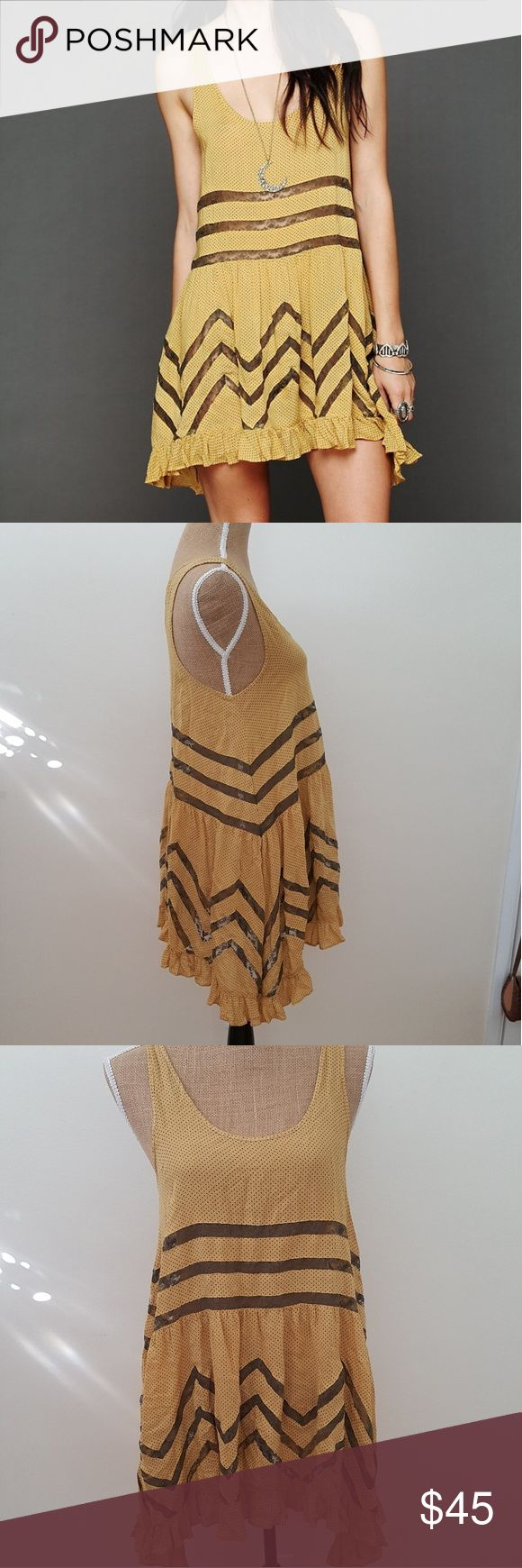 Free People Yellow Voile and Lace Trapeze Dress Lovely mustard yellow and charcoal grey trapeze lace dress by intimately Free People. Dot pattern with lace inset. Excellent condition. Ruffled hem. Size small.   1120215 Free People Dresses